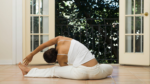 woman doing yoga at home