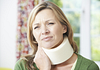 Image of woman wearing a foam neck brace