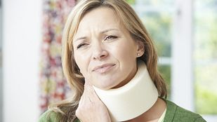 Image of a woman with neck pain wearing a neck brace