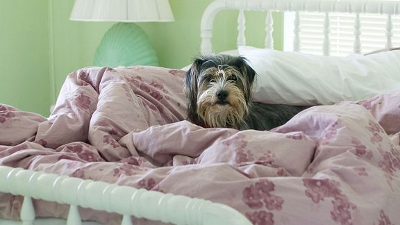 For better sleep, keep your room cool and pile on the blankets.
