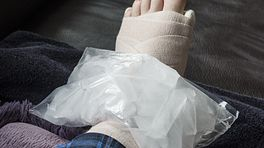 Ice pack placed on a wrapped and elevated ankle