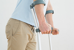 Closeup image of a man using crutches