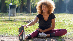 Image of woman stretching at the park