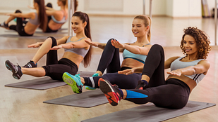 Women in a studio for an aerobics class.