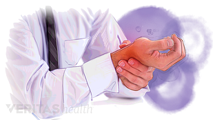 illustration of person holding painful wrist