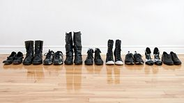 Line of shoes on a hardwood floor.
