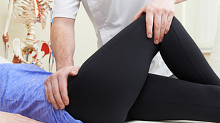 Image of physical therapist manipulating a patient's hip