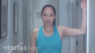 Video still of woman starting the levator scapula stretch