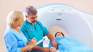 imagine of medical staff preparing patient for CT scan