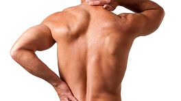 Man grabbing neck and back in pain