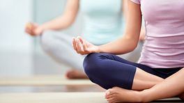 Two women in seated yoga posture