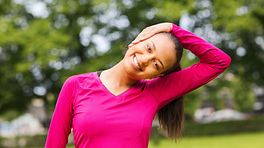 Woman stretching neck in the park