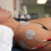 Image of person getting transcutaneous electrical nerve stimulation TENS therapy on their shoulder