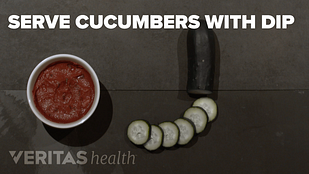 image of beet dip with cucumber slices