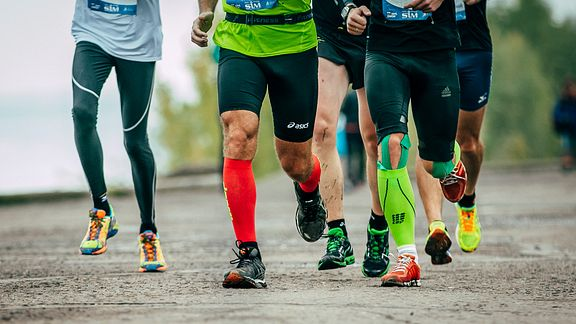 Group of runners wearing different types of compression garments