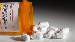 Hydrocodone opioid medication spilled on tabletop