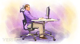 Man sitting in office chair which supports his neck