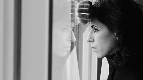 Woman gazing sadly out of the window