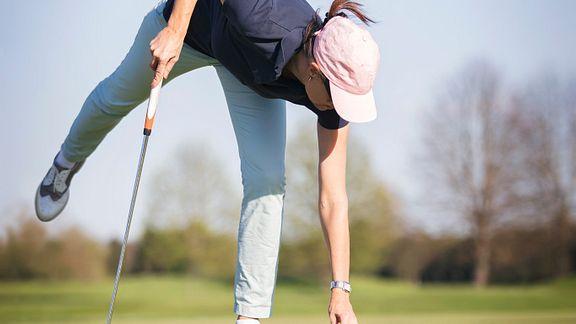 Woman using golf lift