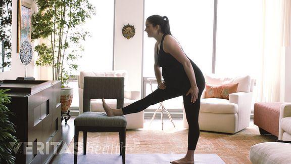 Pregnant women doing hamstring stretch