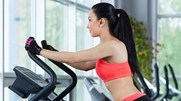 Woman doing aerobic exercise on an elliptical