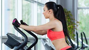 Woman doing aerobic exercise on an elliptical