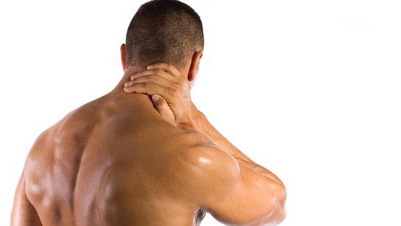 Man grabbing neck in pain.