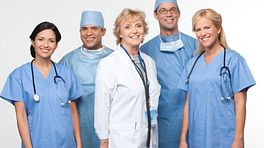 Medical team in scrubs and a doctor.
