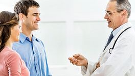 Doctor and couple having a discussion.