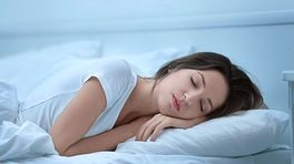 Woman asleep on her stomach and side.