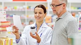 Pharmacist reviews medication with patient