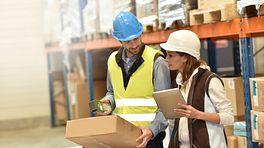 Warehouse employees working ergonomically.