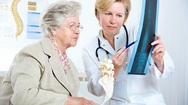 Senior patient reviewing x-ray with a physician
