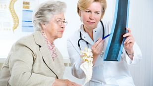 Older woman reviewing and x-ray with the doctor