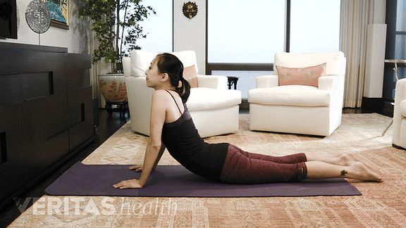 Woman doing the advanced press up exercise for sciatic pain relief