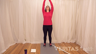 video still of person doing the overhead shoulder stretch