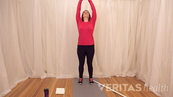 Woman doing the overhead shoulder stretch
