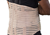 Image of a man's torso with a lower back brace over his shirt