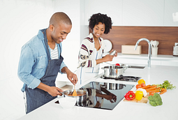 Image of a couple cooking together