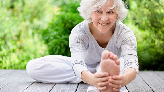 Senior woman doing a hamstring stretch for sciatic pain