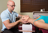 Image of chiropractor adjusting a woman's neck
