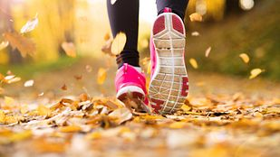 Running feet through fall leaves.