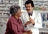 Image of woman talking to pharmacist about prescription medication