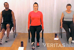 two women and one man demonstrating the seated hamstring stretch for sciatica pain.