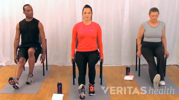 three people performing seated hamstring stretch for sciatica from a herniated disc