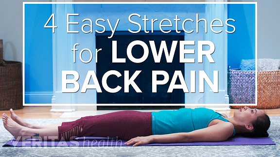 Image of woman laying on yoga mat with the title 4 Easy Stretches for Lower Back Pain overlaid in a blue box