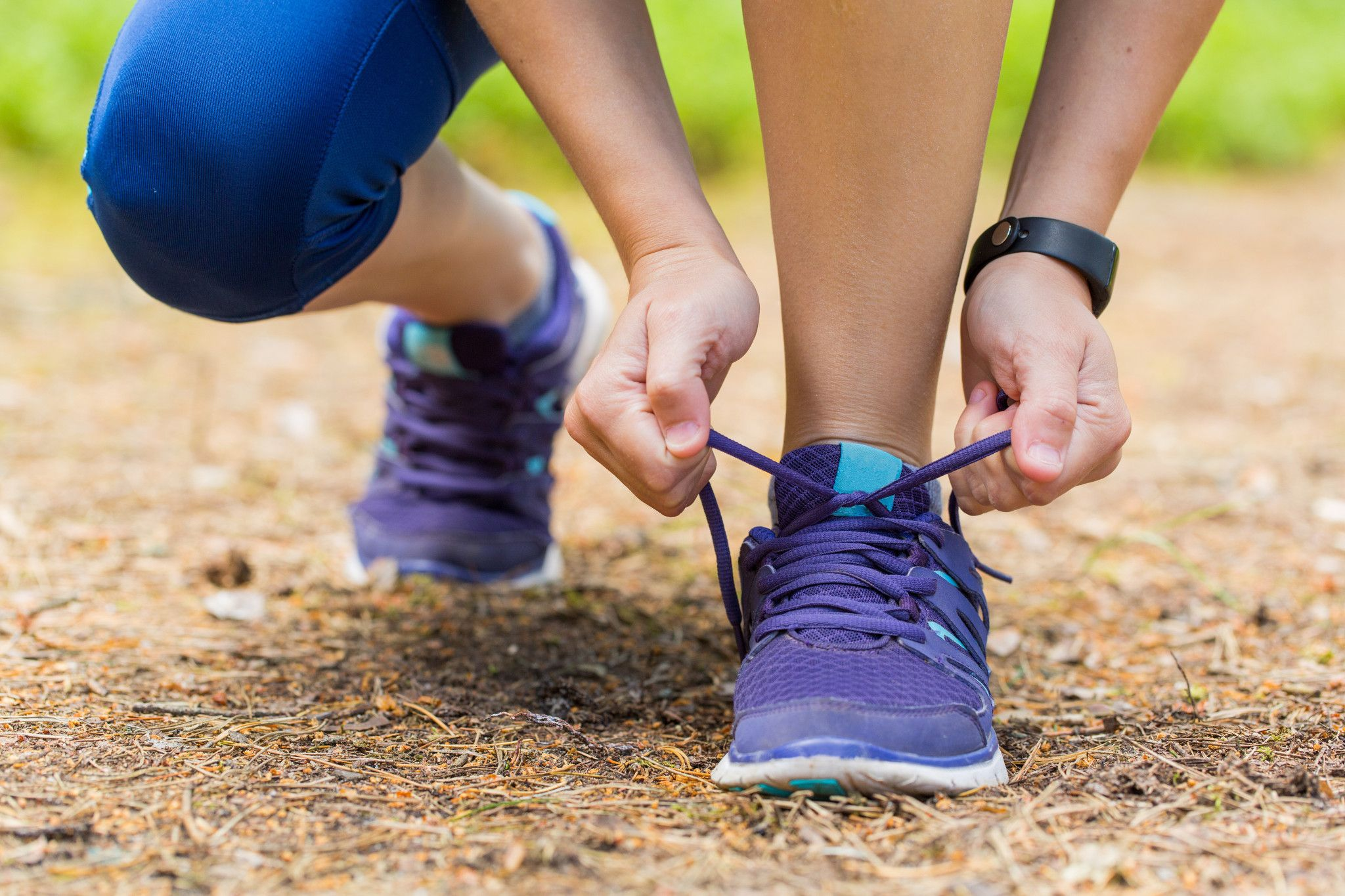 tying athletic shoes