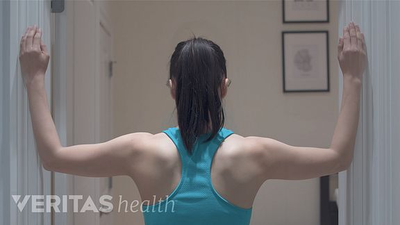 Woman doing the corner neck stretch