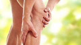 Grabbing knee and calf in pain