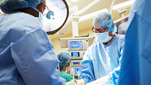 Surgeons operating in an operating room